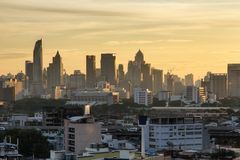 Aerial view modern office buildings in Bangkok city downtown with sunrise time Royalty Free Stock Images