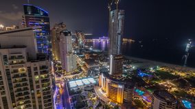 Aerial view of modern skyscrapers and beach at Jumeirah Beach Residence JBR night timelapse in Dubai, UAE stock footage