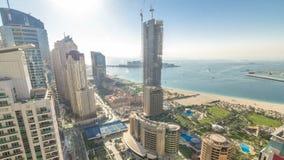 Aerial view of modern skyscrapers and beach at Jumeirah Beach Residence JBR timelapse in Dubai, UAE stock video