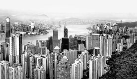 Aerial view of modern skyscrapers of Hong Kong island from the top of Victoria peak. Black and white colors stock photography