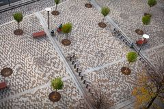 Aerial view. Modern small cobbled square with parking bikes, bic Royalty Free Stock Images