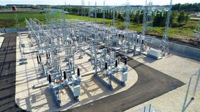 Aerial view transformation substation among pictorial landscape. Aerial view modern transformation substation with high voltage lines among pictorial green stock video footage