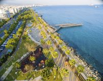 Aerial view of Molos, Limassol, Cyprus. Aerial view of Molos Promenade on the coast of Limassol city in Cyprus. A view of the walk path surrounded by palm trees Royalty Free Stock Photography