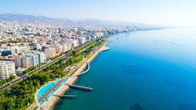 Aerial view of Molos, Limassol, Cyprus. Aerial view of Molos Promenade park on the coast of Limassol city centre in Cyprus. Bird`s eye view of the jetties royalty free stock photo