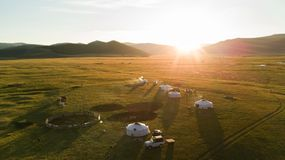 Aerial view of Mongolian ger community at sunset. royalty free stock photo