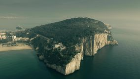 Aerial view of the Montagna Spaccata or Broken Mountain, a sharply vertical cliff, in Gaeta, Italy stock images