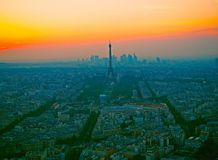 Aerial view, from Montparnasse tower at sunset, view of the Eiffel Tower and La Defense district in Paris, France. Royalty Free Stock Images