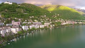 Aerial view on Montreux city over geneva lake stock video footage