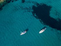 Aerial view of moored boats floating on a transparent sea. Corsica. France Stock Images