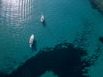 Aerial view of moored boats floating on a transparent sea. Corsica. France Royalty Free Stock Image