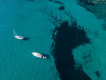 Aerial view of moored boats floating on a transparent sea. Corsica. France Stock Photo