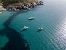 Aerial view of moored boats floating on a transparent sea. Corsica. France Royalty Free Stock Photo