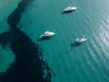 Aerial view of moored boats floating on a transparent sea. Corsica. France Stock Image