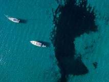 Aerial view of moored boats floating on a transparent sea. Corsica. France Royalty Free Stock Photos