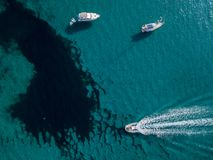Aerial view of moored boats floating on a transparent sea. Corsica. France Royalty Free Stock Photography