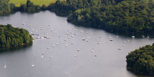 Aerial View : Mooring sail boats in a lake. Surrounding by forrests Royalty Free Stock Photos
