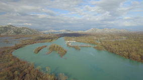 Aerial view of Moraca river which flows into beauty big Skadar lake stock video footage