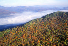 Aerial view of morning fog over mountains near Stowe, VT in autumn along Scenic Route 100 Royalty Free Stock Photos