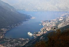 Aerial view of morning Kotor fjord, cruise ship. Montenegro. This the bird`s eye view of the beautiful morning Kotor bay with the large cruise ship and unique stock photography