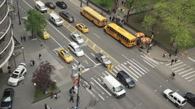 Aerial view of morning traffic at an intersection. A view of a typical New York City intersection stock video