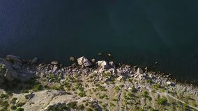 Aerial View: morning view of the sea through the rocks in the Crimea. Beautiful view of Blue bay from cape Kapchik in 4K stock video