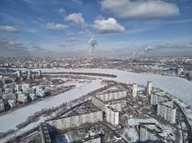 Aerial view of Moscow river near kolomenskoe and pechatniki district. Aerial view from drone to winter snow river. A lot of ice stock photo