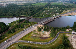 Aerial view of motor bridge under construction beltway St. Peter. Saint Petersburg, Russia - July 19, 2007: Ring Road crosses the river Big Ohta, it is near the stock image