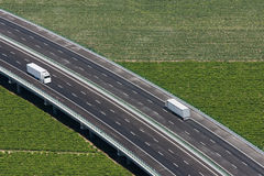 Aerial view of motorway with two white trucks Stock Image