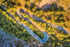 Aerial view of mountain curve road with cars, green forest Stock Images