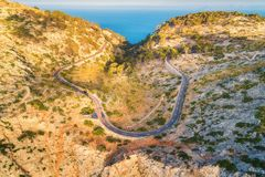 Aerial view of mountain curve road with cars, green forest Stock Photography