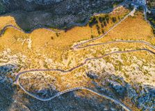 Aerial view of mountain curve road with cars, green forest Stock Image