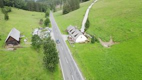 Chalet in alps. Aerial view mountain and forest landscape of alps with chalet and road stock video