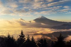 Aerial view of Mountain Fuji with morning mist or fog at sunrise. In Fujikawaguchiko, Yamanashi, Japan. Landscape with hills stock image