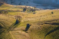 Aerial view of mountain homestead. Autumn aerial shot of a ranch, homestead in Apuseni mountains. Drone view of rural place in Transylvania, Romania stock photos
