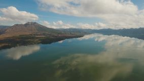 Lake Batur. Bali,Indonesia. Aerial view mountain lake, clouds, blue sky, Bali, Indonesia. Mountain landscape. 4K video. Travel concept Aerial footage stock video footage