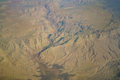 Aerial view of mountain landscape, view from window seat in an a Royalty Free Stock Images
