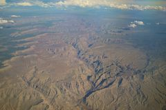 Aerial view of mountain landscape, view from window seat in an a Stock Photos