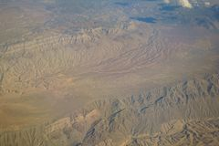Aerial view of mountain landscape, view from window seat in an a Royalty Free Stock Image