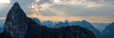 Aerial view mountain range image at sunset ray from Moon Hill. With amazing sunlight. Yangshuo, China, Asia Stock Images