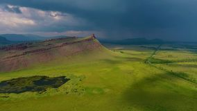 Aerial view of the mountain range Sunduki, green fields sky before the storm in the Republic of Khakassia. Russia.  stock video footage