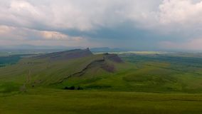 Aerial view of the mountain range Sunduki, green fields sky before the storm in the Republic of Khakassia. Russia.  stock video
