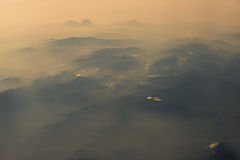 Aerial view of mountain range view from airplane in morning. Aerial view of mountain range view from airplane in morning Stock Image