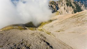Aerial view of mountain ridge surrounded with clouds. Stol in Karavanke, Slovenia Royalty Free Stock Photography