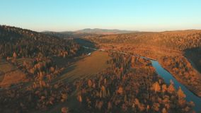 Aerial View of the mountain river. Country landscape at sunset. Shooting with quadrocopter. Aerial View of the mountain river. Country landscape at sunset stock video footage