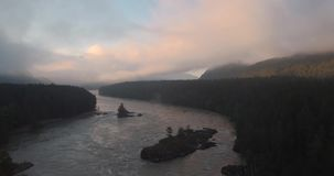 Aerial view. Mountain river over which is born and floats fog. Russia, Mountain Altai, Katun river. 4K. Aerial view. Mountain river over which is born and floats stock video footage