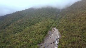 Aerial View Mountain River Runs along Plain Stone Canyon Part. Amazing aerial view fast mountain river runs along plain stone canyon part among tropical woods stock footage