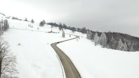Aerial view of the mountain road. Winter aerial view above the mountain road stock video footage