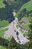 Aerial view of mountain stream in the Austrian Alps blocked after a massive mudflow with excavator and truck working to clean up royalty free stock images