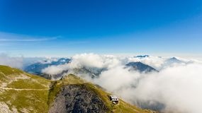 Aerial view of mountain top with cabin. Stol in Karavanke, Slovenia royalty free stock photography
