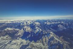 Aerial View of Mountain Under Blue Sky during Day Time Stock Photo
